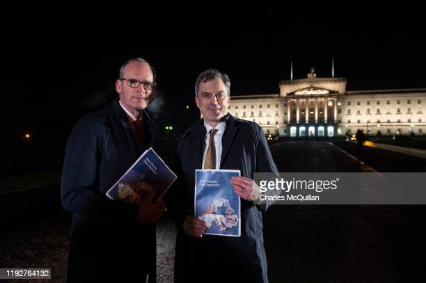 Northern Ireland Secretary of State Julian Smith and Irish Tanaiste Simon Coveney pose with the text draft after making a statement to the media at...
