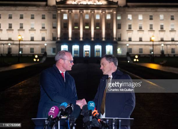 IRELAND JANUARY Northern Ireland Secretary of State Julian Smith shakes hands with Irish Tanaiste Simon Coveney as they make a statement to the media...