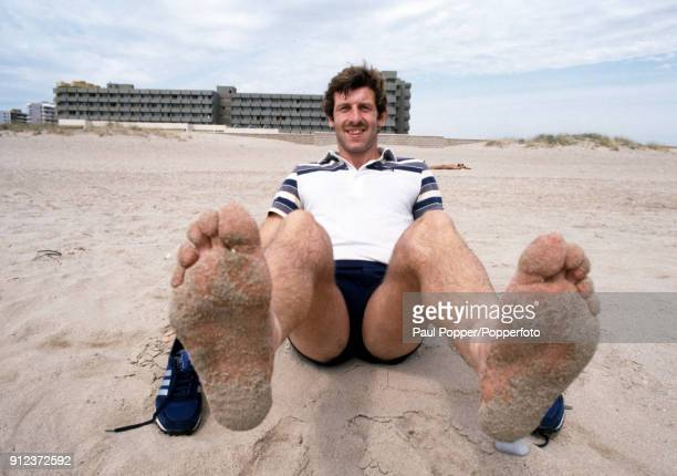 Northern Ireland striker Gerry Armstrong puts his feet up on the beach the morning after scoring the winning goal against Spain in their FIFA World...