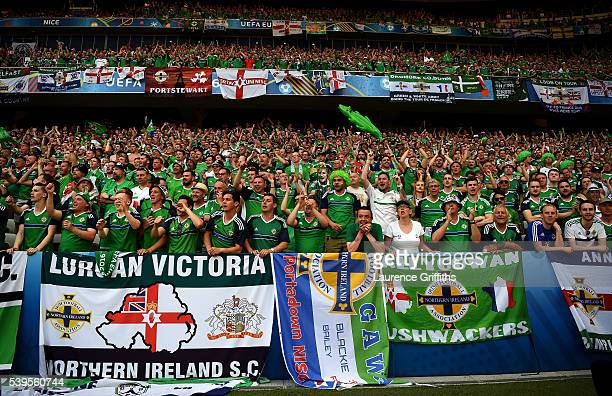 Northern Ireland supporters cheer after the UEFA EURO 2016 Group C match between Poland and Northern Ireland at Allianz Riviera Stadium on June 12...
