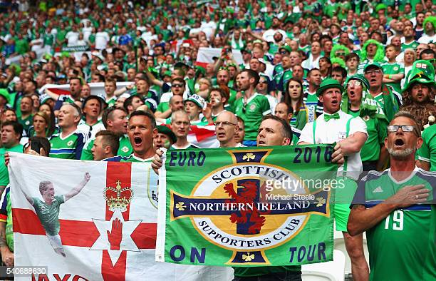 Northern Ireland supporters cheer during the UEFA EURO 2016 Group C match between Ukraine and Northern Ireland at Stade des Lumieres on June 16 2016...