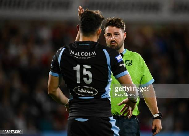 Northern Ireland , United Kingdom - 24 September 2021; Referee Ben Whitehouse speaks to Cole Forbes of Glasgow Warriors before showing him a yellow...
