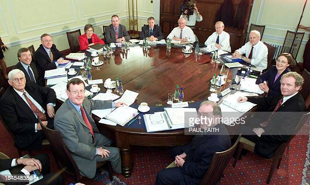 Northern Ireland's Cabinet sits at Stormont in Belfast 01 June 2000 for the first time in more than three months after getting a second chance to...
