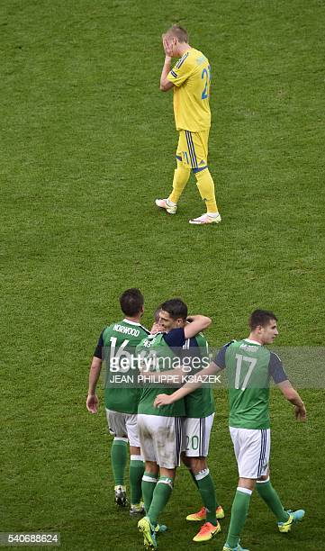 Northern Ireland's celebrate after winning the Euro 2016 group C football match between Ukraine and Northern Ireland at the Parc Olympique Lyonnais...