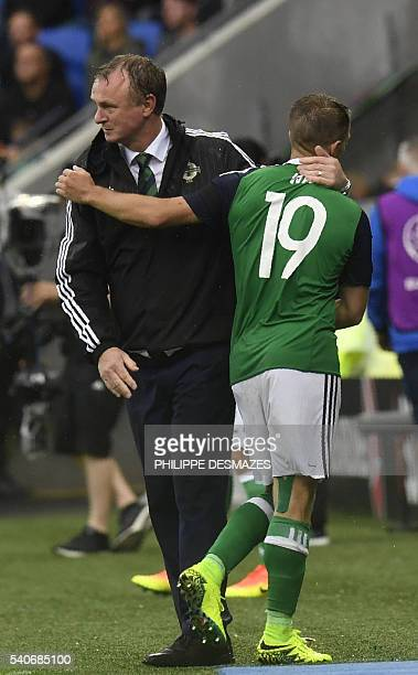 Northern Ireland's coach Michael O'Neill greets Northern Ireland's midfielder Jamie Ward during the Euro 2016 group C football match between Ukraine...