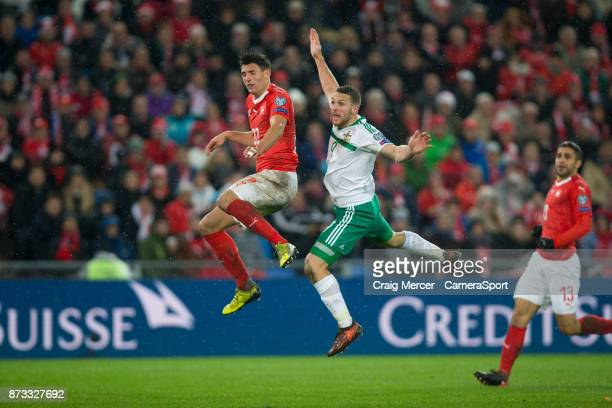 Northern Ireland's Conor Washington watches after an effort on goal during the FIFA 2018 World Cup Qualifier PlayOff Second Leg between Switzerland...