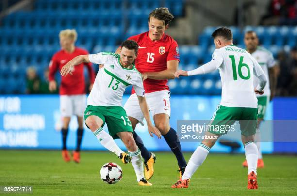 Northern Ireland's Corry Evans and Norway's Sander Berge vie for the ball during the FIFA World Cup 2018 qualification football match between Norway...