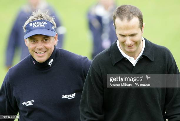 Northern Ireland's Darren Clarke and England test cricket player Michael Vaughn share a joke during a practice session at Kingsbarns Golf Course Fife