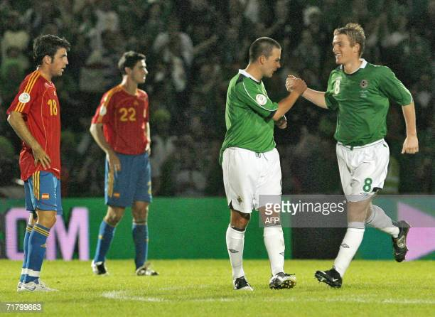 Northern Ireland's David Healy and Steve Davis celebrate Healy's winning goal as Spain's Cesc Fabregas and Pablo Ibanez look on during their Euro...