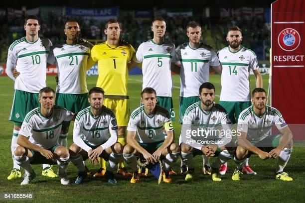 Northern Ireland's defender Aaron Hughes Northern Ireland's midfielder Oliver Norwood Northern Ireland's midfielder Steven Davis Northern Ireland's...