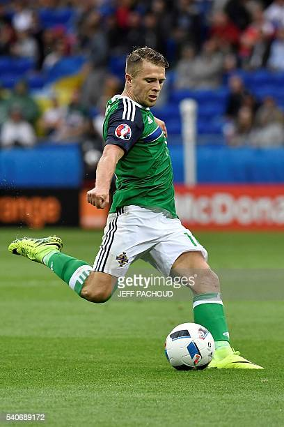Northern Ireland's defender Aaron Hughes plays the ball during the Euro 2016 group C football match between Ukraine and Northern Ireland at the Parc...