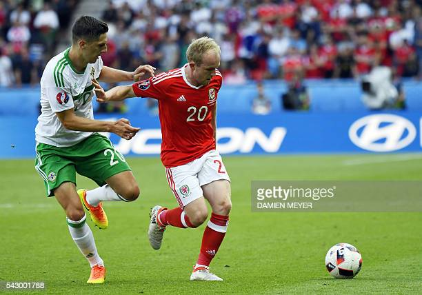 Northern Ireland's defender Craig Cathcart vies for the ball against Wales' midfielder Jonathan Williams during the Euro 2016 round of sixteen...