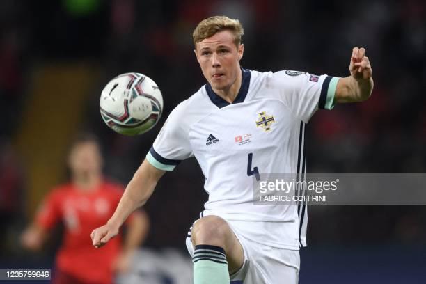 Northern Ireland's defender Daniel Ballard controls the ball during FIFA World Cup Qatar 2022 qualification football match between Switzerland and...