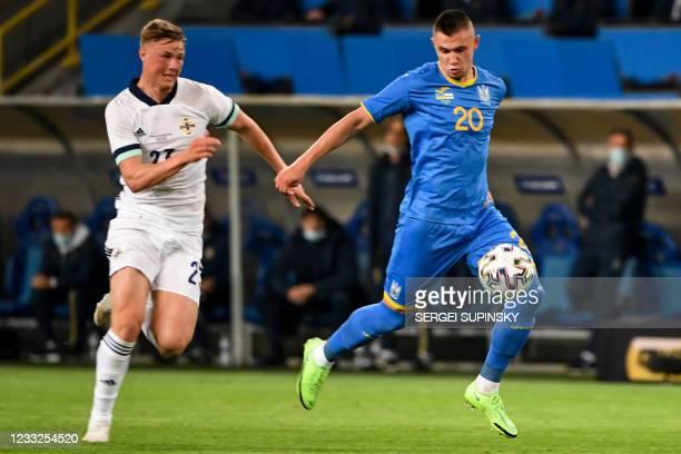 Northern Ireland's defender Danny Ballard and Ukraine's midfielder Oleksandr Zubkov vie for the ball during the friendly football match Ukraine v...