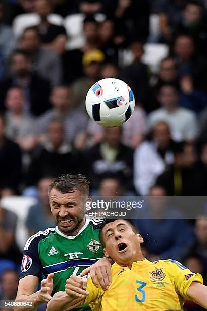 Northern Ireland's defender Gareth McAuley and Ukraine's defender Yevhen Khacheridi vie for the ball during the Euro 2016 group C football match...