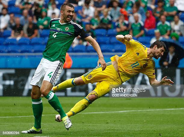 Northern Ireland's defender Gareth McAuley and Ukraine's forward Yevhen Seleznyov vie for the ball during the Euro 2016 group C football match...