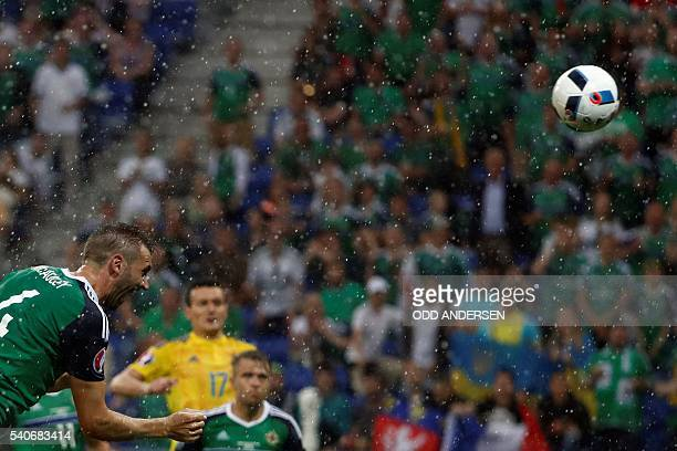 Northern Ireland's defender Gareth McAuley scores the opening goal during the Euro 2016 group C football match between Ukraine and Northern Ireland...