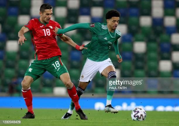 Northern Ireland's defender Jamal Lewis vies with Bulgaria's midfielder Ivaylo Chochev during the FIFA World Cup Qatar 2022 Group C qualification...