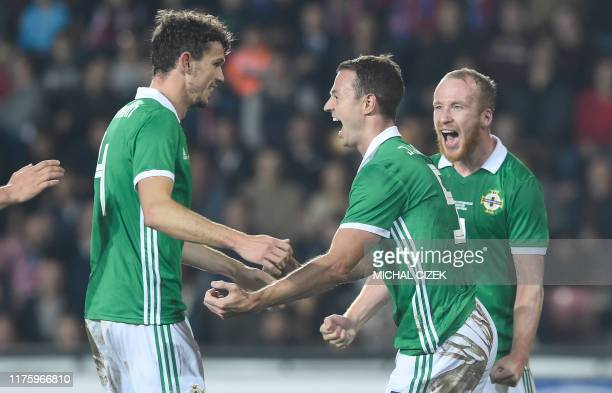Northern Ireland's defender Jonny Evans celebrates with his teammates after scoring during the international friendly football match between Czech...