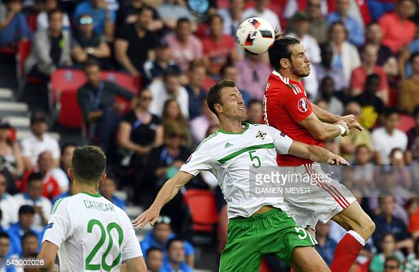 Northern Ireland's defender Jonny Evans vies for the ball with Wales' forward Gareth Bale during the Euro 2016 round of sixteen football match Wales...