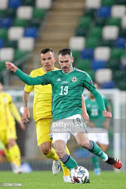 Northern Ireland's defender Michael Smith passes the ball during the UEFA Nations League group b1 football match between Northern Ireland and Romania...