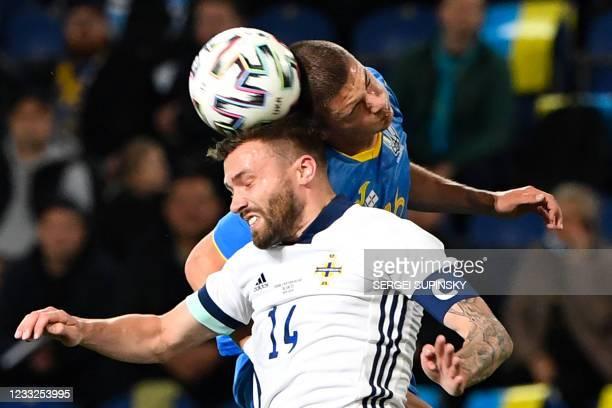 Northern Ireland's defender Stuart Dallas and Ukraine's defender Vitaliy Mykolenko vie for the ball during the friendly football match Ukraine v...
