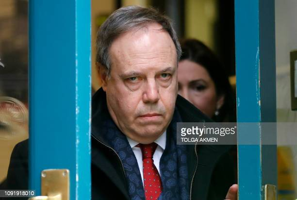 Northern Ireland's Democratic Unionist Party deputy leader Nigel Dodds reacts as he leaves the Cabinet Office on Whitehall, in central London on...