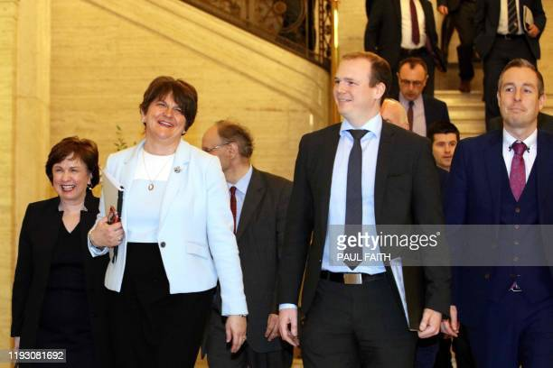 Northern Ireland's Democratic Unionist Party leader Arlene Foster , with party colleagues, make their way into a session of the Northern Ireland...