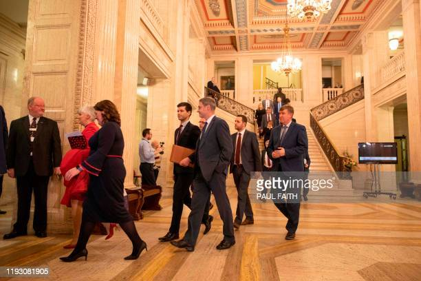 Northern Ireland's Democratic Unionist Party members make their way into a session of the Northern Ireland Assembly at the Parliament Buildings on...