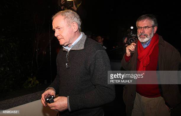 Northern Ireland's deputy first minister, Martin McGuinness , and Sinn Fein President Gerry Adams arrive at the Stormont hotel in Belfast, Northern...