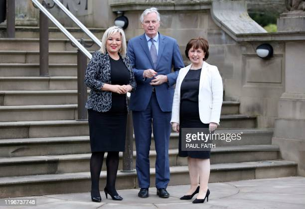 Northern Ireland's Deputy First Minister Michelle O'Neill and Ecomony Minister Diane Dodds greet the EU's chief Brexit negotiator Michel Barnier at...