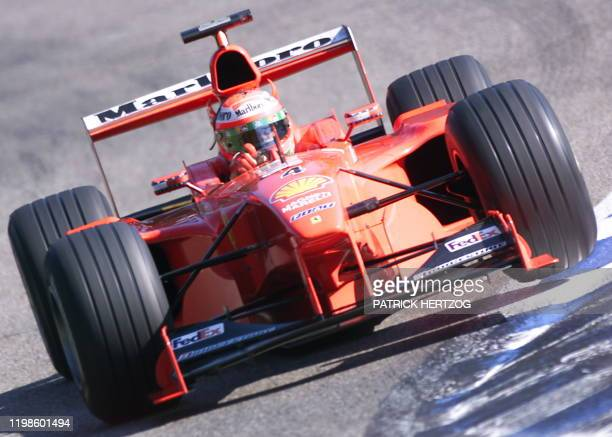 Northern Ireland's Ferrari driver Eddie Irvine steers his car during the third free practice session 31 July 1999 on the Hockenheim racetrack on the...