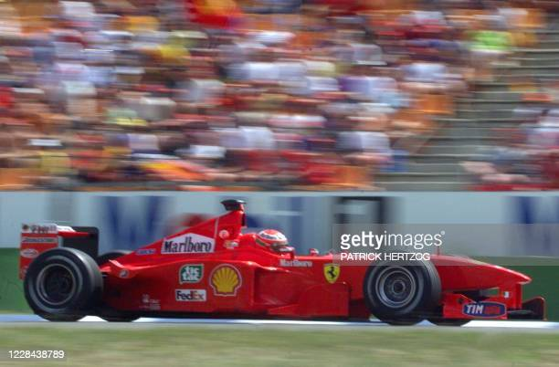 Northern Ireland's Ferrari driver Eddie Irvine steers his car on the Hockenheim racetrack during the qualifying session 31 July 1999 on the eve of...