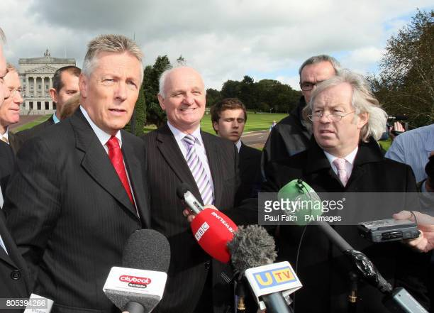 Northern Ireland's First Minister and DUP leader Peter Robinson speaking with the media outside Stormont following a meeting with British Prime...
