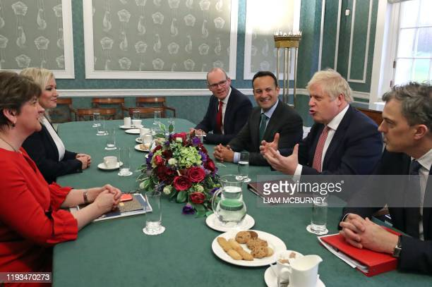 Northern Ireland's First Minister Arlene Foster and Deputy First Minister Michelle O'Neill, Ireland's Foreign Minister Simon Coveney, Ireland's Prime...