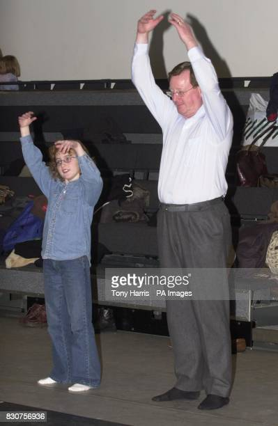 Northern Ireland's First Minister David Trimble and his nine year old daughter Sarah warm up during a Circus Skills Workshop in the Royal Opera House...