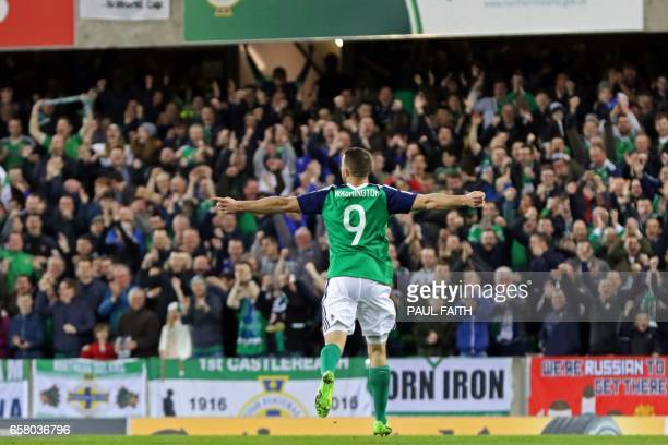 Northern Ireland's forward Conor Washington celebrates after scoring their second goal during the World Cup 2018 qualification football match between...