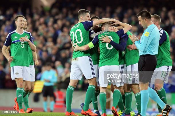 Northern Ireland's forward Conor Washington celebrates with teammates after scoring their second goal during the World Cup 2018 qualification...