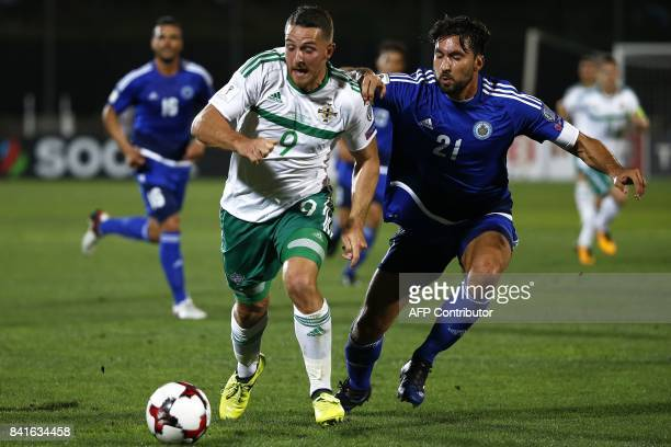 Northern Ireland's forward Conor Washington fights for the ball with San Marino's goalkeeper Mirko Palazzi during the 2018 FIFA World Cup qualifying...