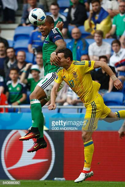 Northern Ireland's forward Josh Magennis and Ukraine's defender Artem Fedetskiy vie during the Euro 2016 group C football match between Ukraine and...