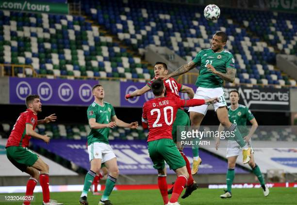 Northern Ireland's forward Josh Magennis jumps to header the ball during the FIFA World Cup Qatar 2022 Group C qualification football match between...