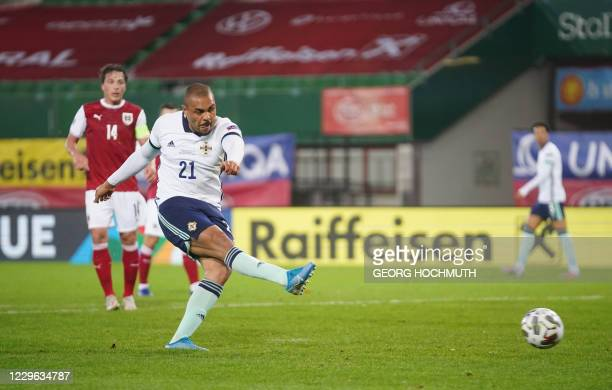 Northern Ireland's forward Josh Magennis scores during the UEFA Nations League football match Austria v Northern Ireland on November 15, 2020 in...