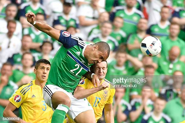 Northern Ireland's forward Josh Magennis vies with Ukraine's defender Artem Fedetskiy during the Euro 2016 group C football match between Ukraine and...