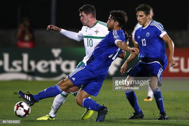 Northern Ireland's forward Kyle Lafferty fights for the ball with San Marino's goalkeeper Mirko Palazzi during the 2018 FIFA World Cup qualifying...