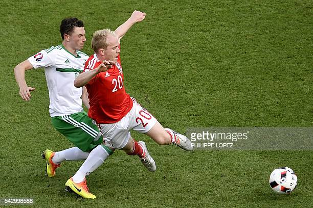 Northern Ireland's forward Kyle Lafferty vies for the ball against Wales' midfielder Jonathan Williams during the Euro 2016 round of sixteen football...