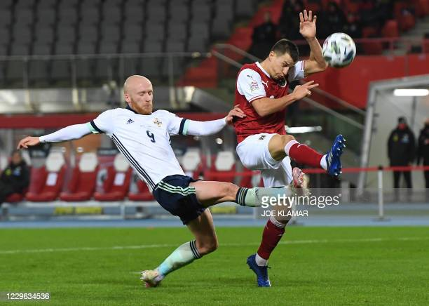 Northern Ireland's forward Liam Boyce and Austria's defender Stefan Lainer vie for the ball during the UEFA Nations League football match Austria v...