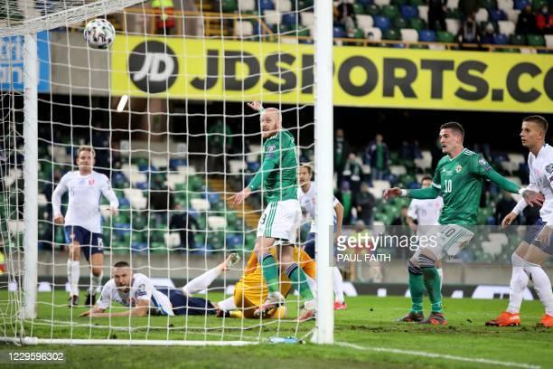 Northern Ireland's forward Liam Boyce and Northern Ireland's forward Kyle Lafferty react after Slovakia's defender Milan Skriniar scores a late own...
