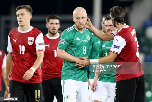 Northern Ireland's forward Liam Boyce shakes hands with Austria's defender Aleksandar Dragovic at the end of the match during the UEFA Nations League...