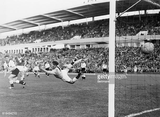Northern Ireland's goalie, Harry Gregg, makes a graceful dive but misses the ball as West Germany's Uwe Seeler scores during the World Cup soccer...
