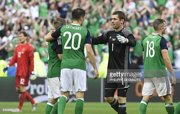 Northern Ireland's goalkeeper Michael McGovern celebrates at the end of the Euro 2016 group C football match between Ukraine and Northern Ireland at...
